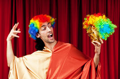 Actor with maks in a funny theater concept. Actor with golden maks in a funny theater concept Royalty Free Stock Photos