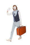 Actor mime waves his hand with orange suitcase Stock Photo