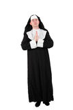 Actor in a nun´s costume with praying hands Stock Photos