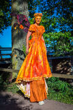 Actor in orange dress Royalty Free Stock Images
