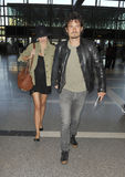 Actor Orlando Bloom with wife Miranda Kerr at LAX Stock Image