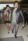 Actor Orlando Bloom with wife Miranda Kerr at LAX Royalty Free Stock Photo