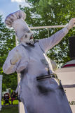 Actor performing in a chef costume. Artist dressed as a cooking chef looking scared during an open air performance at International Festival of Living Statues Stock Photo