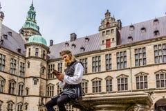 Actor performing Prince Hamlet at Kronborg Castle. Actor performing prince Hamlet and reads a book at Kronborg Castle, Elsinor, Denmark, May 26, 2017 stock photos