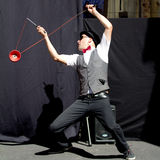 Actor playing diabolo. AURILLAC, FRANCE - AUGUST 22: Actor playing diabolo as part of the Aurillac International Street Theater Festival, Cie Kiblos,on august Stock Photo