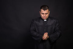 The actor plays the role of a priest Stock Image