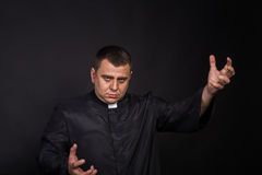 The actor plays the role of a priest Stock Images