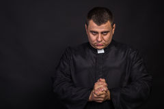 The actor plays the role of a priest Stock Photos