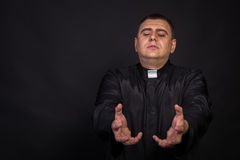 The actor plays the role of a priest Stock Photo