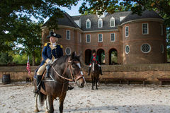 An actor portrays George Washington in historic Williamsburg Va. Historic reenactment of George Washington on horseback in colonial Williamsburg Virginia royalty free stock photo