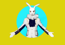 Actor posing in white rabbit suit on color yellow Royalty Free Stock Images