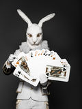 Actor posing in white rabbit suit with playing Stock Images