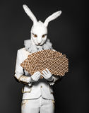 Actor posing in white rabbit suit with playing Stock Photos