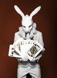 Actor posing in white rabbit suit with playing Royalty Free Stock Photo