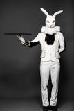 Actor posing in white rabbit suit with tray on Stock Photos