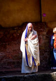 Actor in Roman priest costume at history site Roman Bath, UK Royalty Free Stock Images