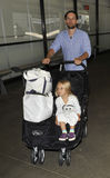 Actor Tobey Maguire with wife at LAX. LOS ANGELES-AUGUST 28: Actor Tobey Maguire with wife and kids at LAX . August 28th in Los Angeles, California 2010 Royalty Free Stock Photos