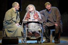Actoren M.Politsemaiko, I.Pekhovych en S.Trifonov op stadium royalty-vrije stock afbeeldingen