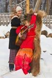 Actoren op een traditionele slavic de wintervakantie. Royalty-vrije Stock Foto's