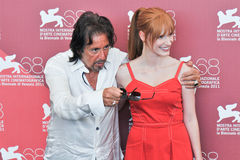 Actors Al Pacino and Jessica Chastain. VENICE - SEPTEMBER 4: Actors Al Pacino and Jessica Chastain poses at photocall during the 68th Venice Film Festival at Royalty Free Stock Images