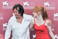 Actors Al Pacino and Jessica Chastain. VENICE - SEPTEMBER 4: Actors Al Pacino and Jessica Chastain poses at photocall during the 68th Venice Film Festival at Royalty Free Stock Photography