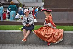 Actors in carnival costumes rest in the center of Moscow. Royalty Free Stock Photography