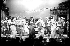 Actors in costumes dancing and singing on stage stock video footage
