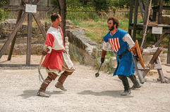 Actors doing a theatrical staging as medieval fighters in the castle of Baux-de-Provence. royalty free stock photos