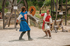 Actors doing a theatrical staging as medieval fighters in the castle of Baux-de-Provence. stock photography