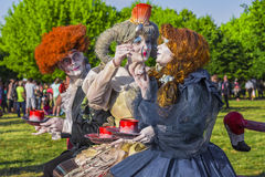 Actors dressed as characters from Alice in Wonderland Stock Photography