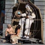 Actors looking at a big white bear. Stock Photos
