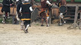 Actors in medieval suits having break during historical movie shoot, reenactment. Stock footage stock video footage