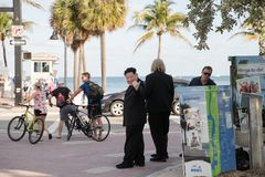 Actors playing Trump and Kim Jong-Un hold `Fake News` poster. Fort Lauderdale Beach Stock Photos