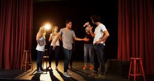 Actors practicing dance on stage 4k. Actors practicing dance on stage in theater 4k stock footage