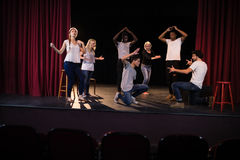 Actors practicing play on stage. In theatre Stock Photo