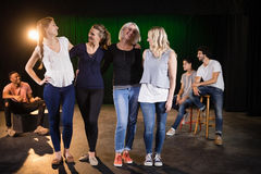 Actors practicing play on stage. In theatre stock image