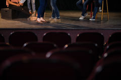 Actors practicing play on stage in theatre Royalty Free Stock Photography