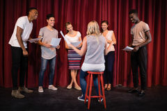 Actors reading their scripts on stage Royalty Free Stock Photos