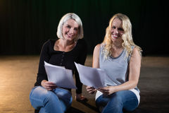 Actors reading their scripts on stage Stock Photography
