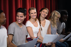 Actors reading their scripts on stage Royalty Free Stock Image