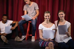 Actors reading their scripts on stage Stock Image