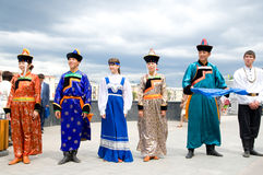 Actors in Russian and Buryat national costumes Stock Image