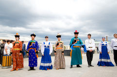 Actors in Russian and Buryat national costumes Stock Photo
