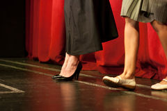 Actors at theater play. Actors legs at theater play Stock Image