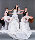 Actors in the wedding dress dancing. Stock Photos