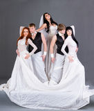 Actors in the wedding dress posing. Stock Photos