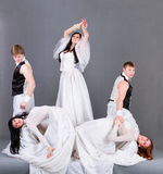 Actors in the wedding dress posing. Royalty Free Stock Photography