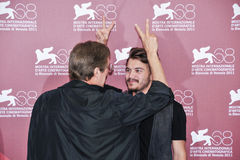 Actors William Friedkin and Emile Hirsch. VENICE - SEPTEMBER 8: Actors William Friedkin and Emile Hirsch poses at photocall during the 68th Venice Film Festival Royalty Free Stock Photo