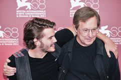 Actors William Friedkin and Emile Hirsch. VENICE - SEPTEMBER 8: Actors William Friedkin and Emile Hirsch poses at photocall during the 68th Venice Film Festival Stock Photos