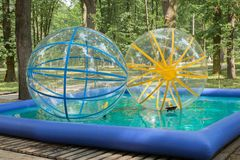 Actraction large balls in the pool in the park.  stock photography